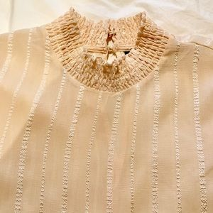 sheer beige blouse with stitching detail